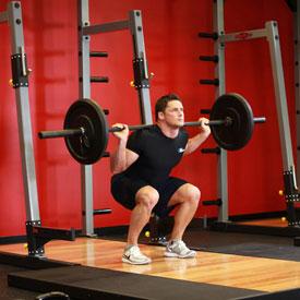 Комплекс упражнений для мышц ягодиц. Приседания со штангой.