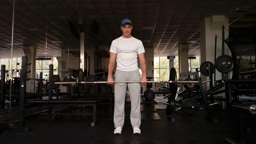 Шраги со штангой. Упражнение для трапециевидных мышц.