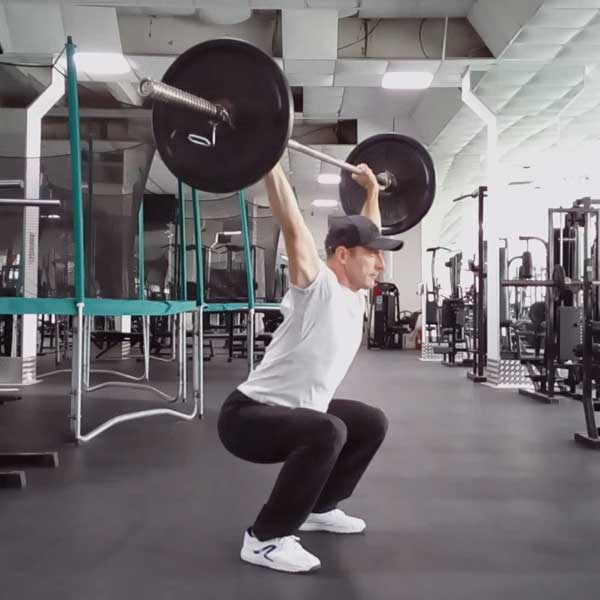 Упражнение для укрепления спины - приседания со штангой над головой