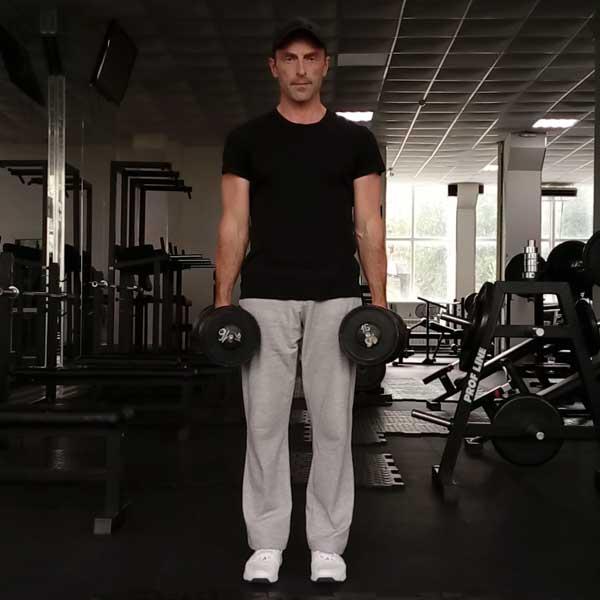 Упражнение с гантелями для спины - шраги